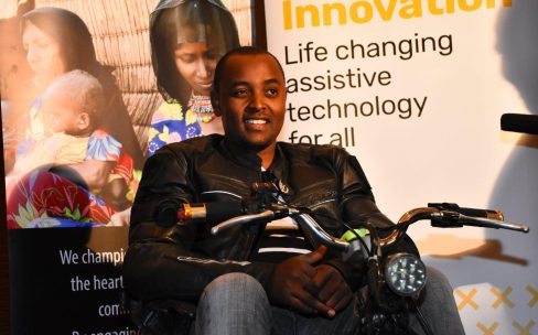 Lincoln Wamae, the founder of Linccell Technology is shown sitting in one of the wheelchairs he has designed.